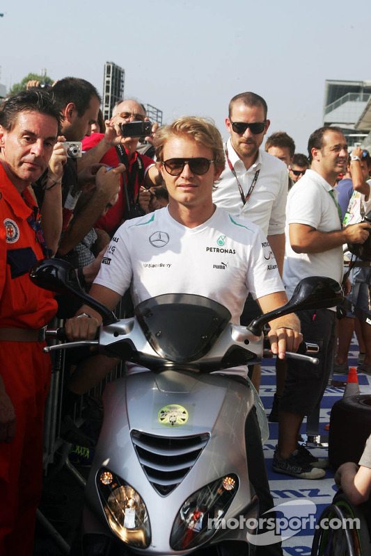 Nico Rosberg, Mercedes AMG F1 on a moped nos pits