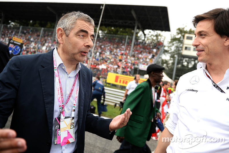 (L to R): Rowan Atkinson, Actor with Toto Wolff, Mercedes AMG F1 Shareholder and Executive Director on the grid