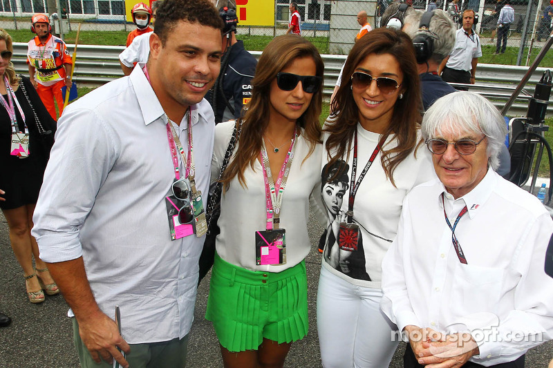 Bernie Ecclestone, CEO Formula One Group, with fiance Fabiana Flosi, and Ronaldo, on the grid