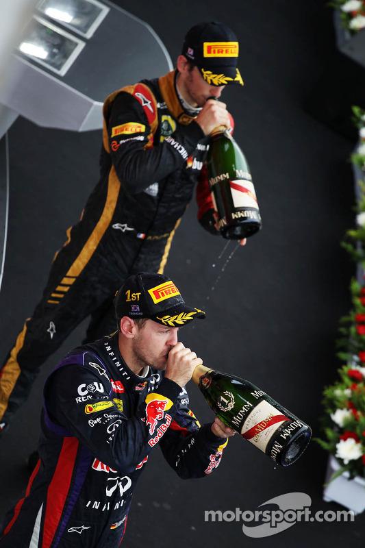 Race winner Sebastian Vettel, Red Bull Racing celebrates on the podium with third placed Romain Gros