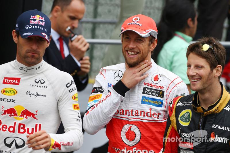 (L naar R): Mark Webber, Red Bull Racing; Jenson Button, McLaren; en Romain Grosjean, Lotus F1 Team bij de rijdersparade