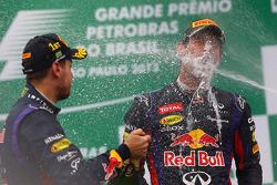 Race winner Sebastian Vettel, Red Bull Racing celebrates on the podium with team mate Mark Webber, Red Bull Racing