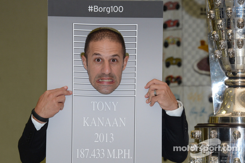 Tony Kanaan plays around during the presentation of his likeness on the Borg-Warner Trophy