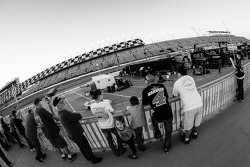 Fans watch garage activity from a top the garage building