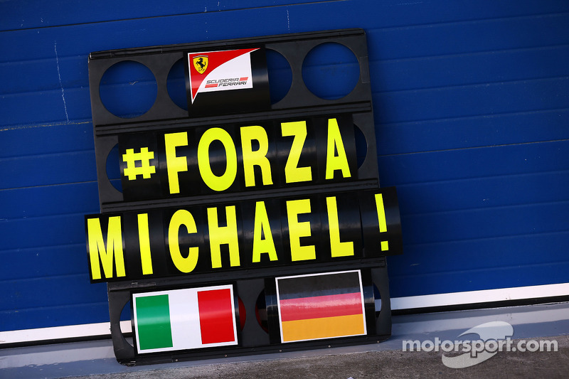 A Ferrari pit board with a message of support for Michael Schumacher