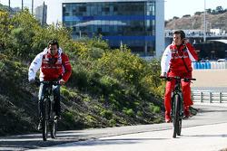 (L to R): Pedro De La Rosa, Ferrari Development Driver cycles the perimiter road with Massimo Rivola