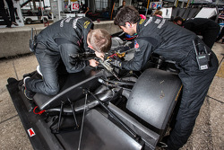 OAK Racing team members at work