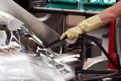 Mercedes AMG F1 W05 pipe attached to engine cover by a mechanic