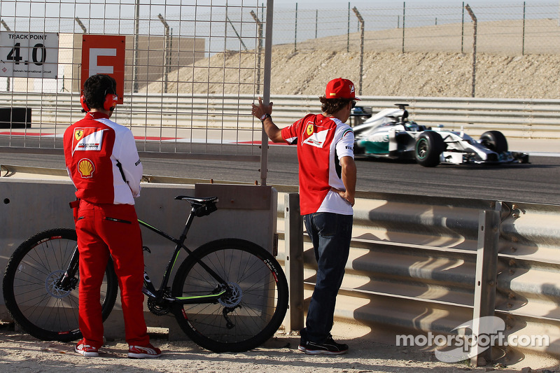 Fernando Alonso, Ferrari watches Nico Rosberg, Mercedes AMG F1 W05 on the circuit