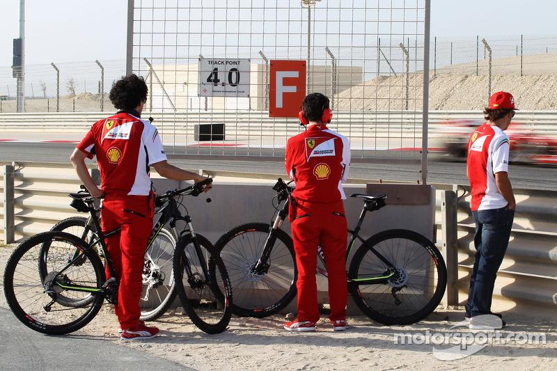 Fernando Alonso, Ferrari watches team mate Kimi Raikkonen, Ferrari F14-T on the circuit