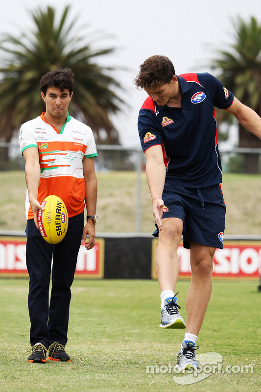 (L to R): Sergio Perez, Sahara Force India F1 practices his Aussie Rules skills with Will Minson, We