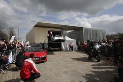 The 2014 Audi R18 e-tron quattro is unloaded on the Place des Jacobins