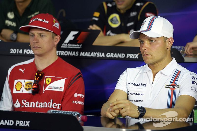 (L to R): Kimi Raikkonen, Ferrari and Valtteri Bottas, Williams in the FIA Press Conference