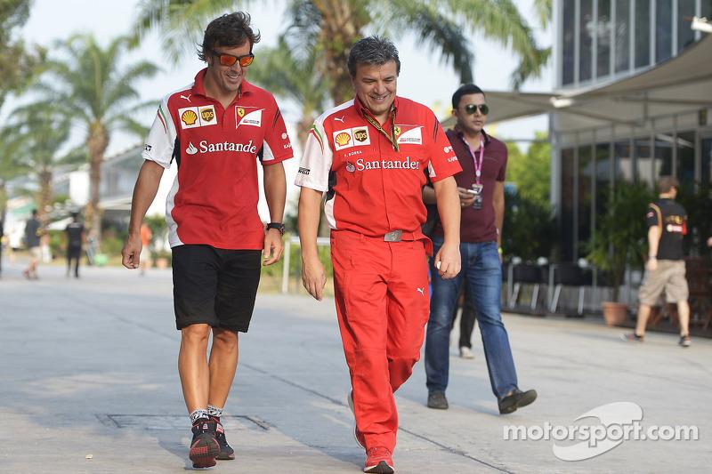 (L to R): Fernando Alonso, Ferrari with Fabrizio Borra, Physio