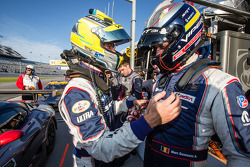 GT pole winner Marc Goossens celebrates with Jonathan Bomarito