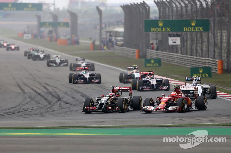 Kimi Räikkönen, Scuderia Ferrari; Romain Grosjean, Lotus F1 Team