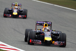 Sebastian Vettel, Red Bull Racing RB10 leads team mate Daniel Ricciardo, Red Bull Racing RB10