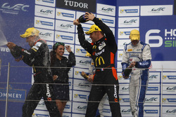 LM P2 podium: winners Roman Rusinov, Olivier Pla, Julien Canal, second place Matthew Howson, Richard Bradley, Tsugo Matsuda, third place Sergey Zlobin, Nicolas Minassian, Maurizio Mediani