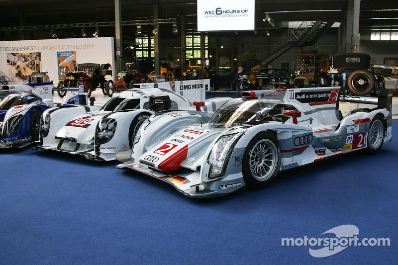 A Toyota TS040 Hybrid, Porsche 919 Hybrid and Audi R18 e-tron quattro on display at the Autoworld mu
