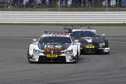 battle between Marco Wittmann, BMW Team RMG, BMW M4 DTM, and Edoardo Mortara, Audi Sport Team Abt, Audi RS 5 DTM,