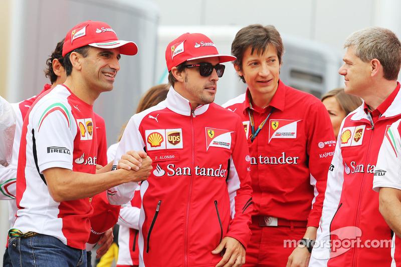 (L to R): Marc Gene, Ferrari Test Driver with Fernando Alonso, Ferrari