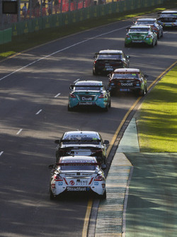 James Courtney, Walkinshaw Andretti United Holden, leads Michael Caruso, Nissan Motorsport Nissan, and Richie Stanaway, Tickford Racing Ford