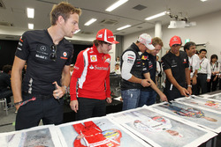 Jenson Button, McLaren, Fernando Alonso, Ferrari, Michael Schumacher, Mercedes GP, Sebastian Vettel, Red Bull Racing and Lewis Hamilton, McLaren sign prints for charity
