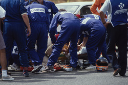 Medical staff tend to Martin Donnelly, Team Lotus, after a horrific crash