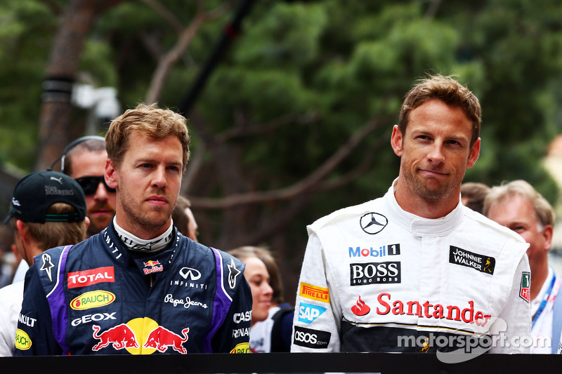 (L to R): Sebastian Vettel, Red Bull Racing and Jenson Button, McLaren, pay their respects to Sir Jack Brabham, on the grid