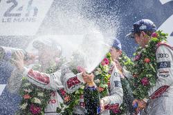 LMP1-H podium: Marcel Fässler, Andre Lotterer, Benoit Tréluyer spray champagne