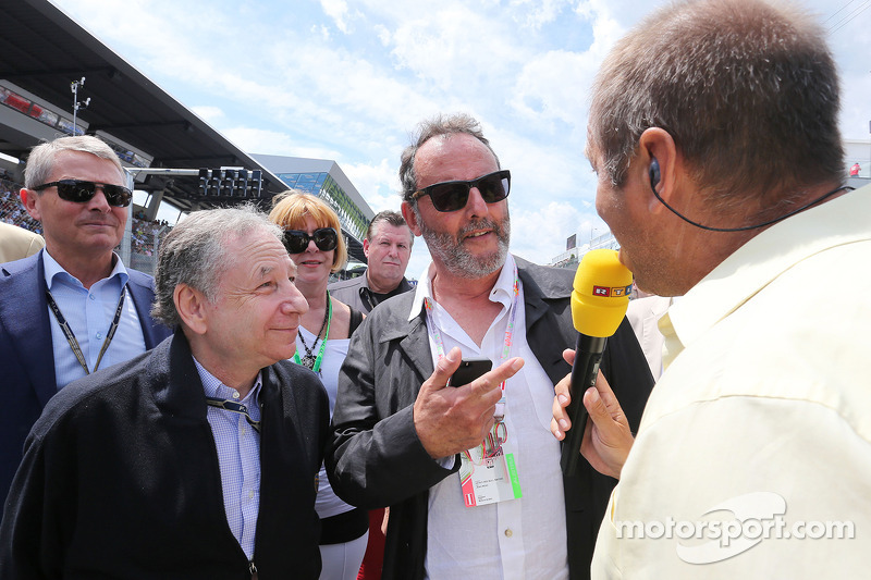 (L to R): Jean Todt, FIA President on the grid with Jean Reno, Actor and Kai Ebel, RTL TV Presenter