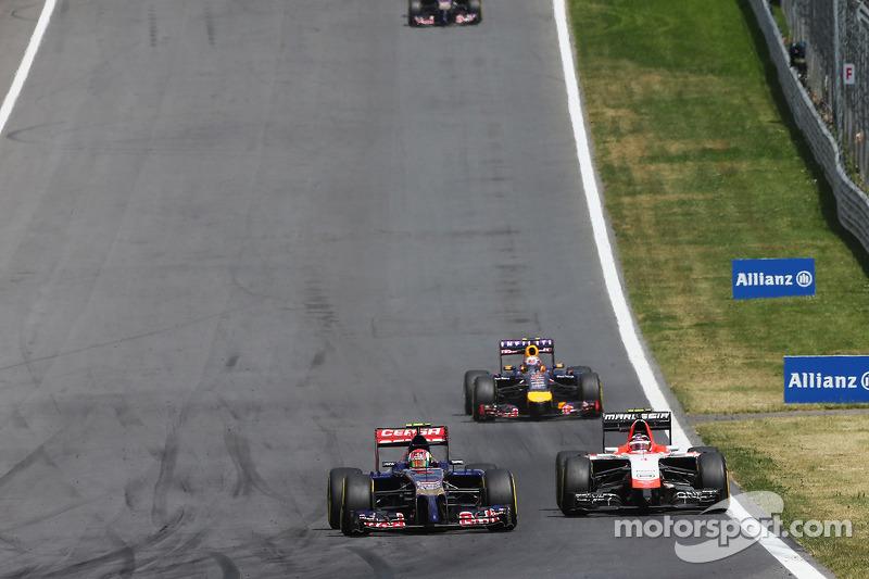 Daniil Kvyat, Scuderia Toro Rosso STR9 and Max Chilton, Marussia F1 Team MR03