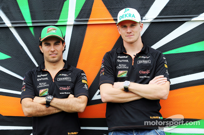 (L to R): Sergio Perez, Sahara Force India F1 and team mate Nico Hulkenberg, Sahara Force India F1 with the team caravan