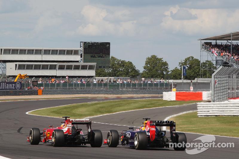Fernando Alonso, Ferrari F14-T and Sebastian Vettel, Red Bull Racing RB10 battle for position