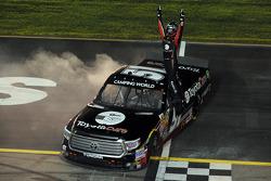 Race winner Erik Jones celebrates