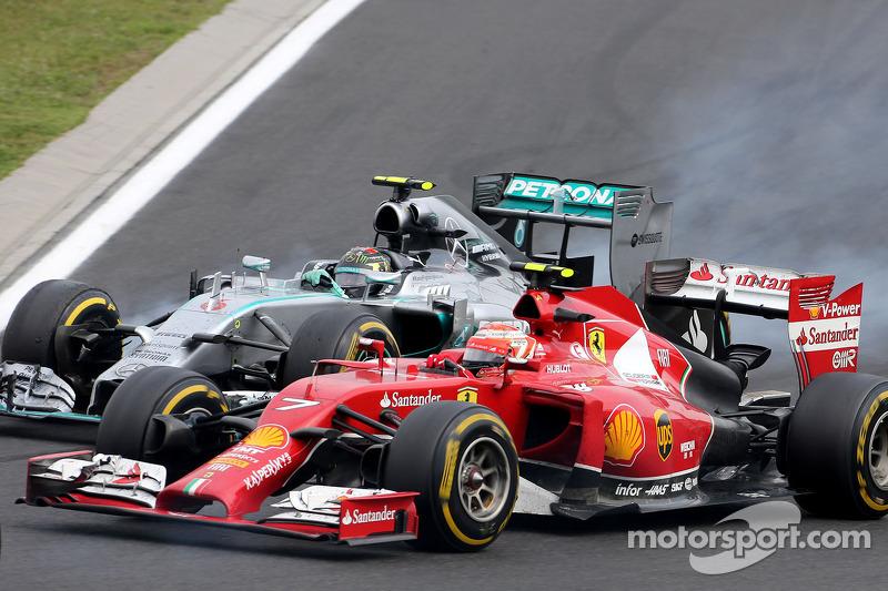 Nico Rosberg, Mercedes AMG F1 Team; Kimi Räikkönen, Scuderia Ferrari