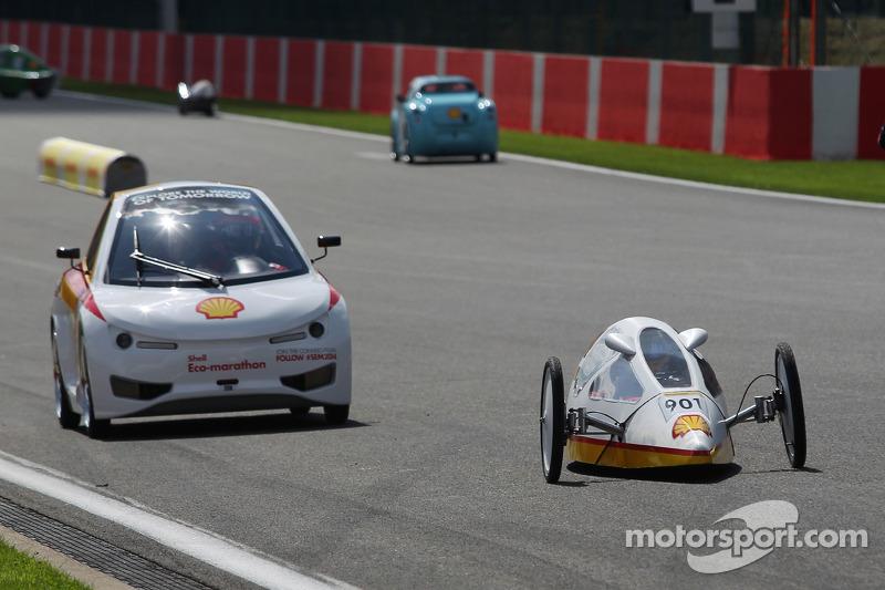 Fernando Alonso, Ferrari and team mate Kimi Raikkonen, Ferrari drive cars from the Shell Eco Marathon