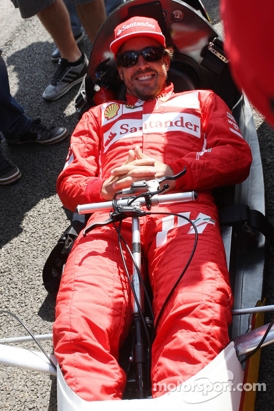 Fernando Alonso, Ferrari drives a car from the Shell Eco Marathon