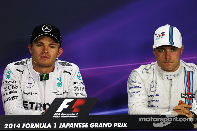 (L to R): Nico Rosberg, Mercedes AMG F1 and Valtteri Bottas, Williams in the FIA Press Conference