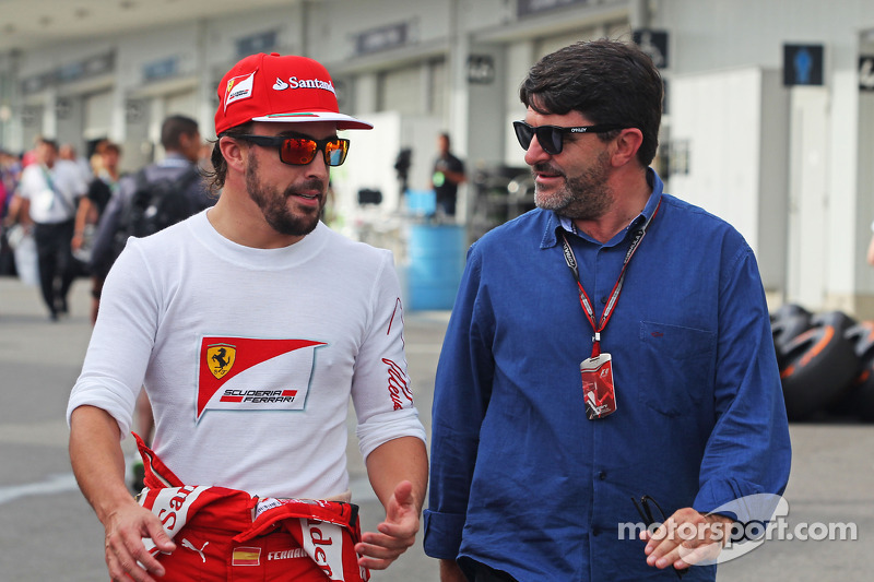 (L to R): Fernando Alonso, Ferrari with Luis Garcia Abad, Driver Manager