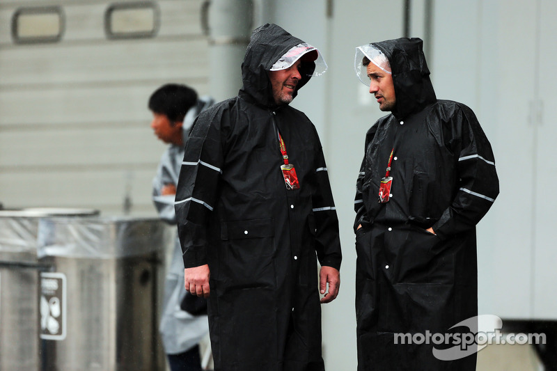 (L to R): Jason Swales, NBC Sports Network and Will Buxton, NBC Sports Network TV Presenter in a wet and rainy paddock