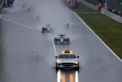Nico Rosberg, Mercedes AMG F1 W05 leads the start of the race behind the FIA Safety Car