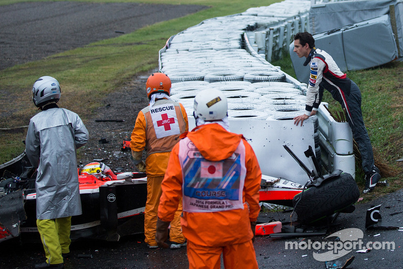Adrian Sutil, Sauber F1 Team looks on as the safety team at work after the crash of Jules Bianchi, M
