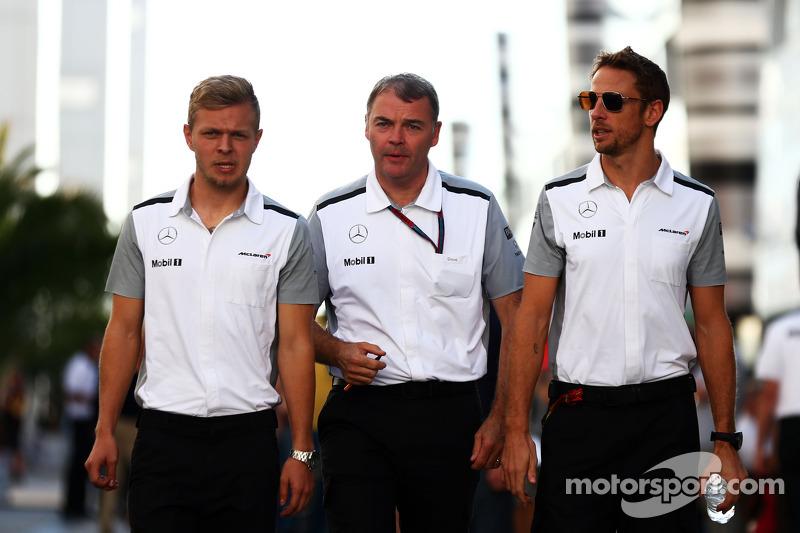 (L to R): Kevin Magnussen, McLaren with Dave Redding, McLaren Sporting Director and Jenson Button, McLaren