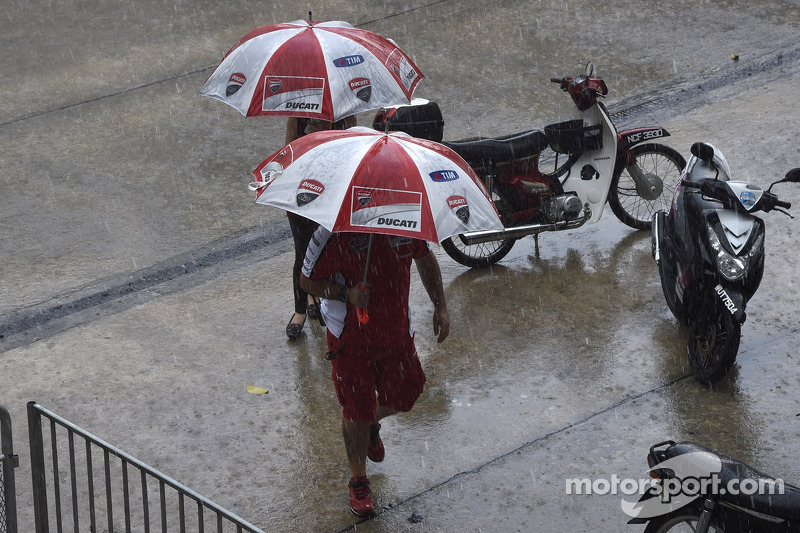 Ducati team members in the rain