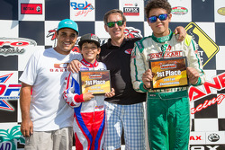Juan Pablo Montoya with son Sebastian Montoya and Christian Munoz