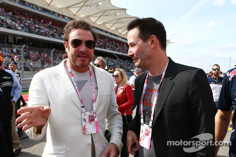 (L to R): Simon Le Bon, Duran Duran Lead Singer with Keanu Reeves, Actor on the grid