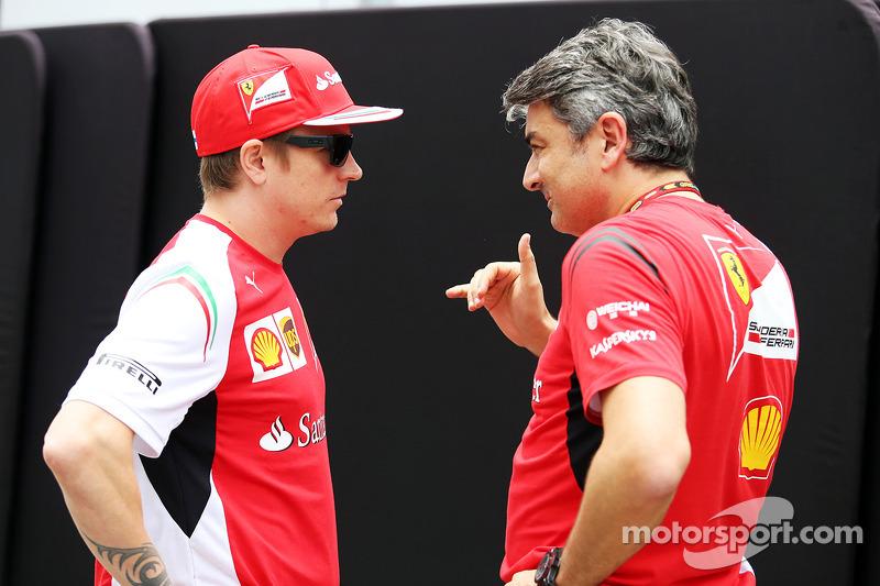 (L to R): Kimi Raikkonen, Ferrari with Marco Mattiacci, Ferrari Team Principal