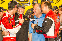 Race winner and 2014 NASCAR Sprint Cup series champion Kevin Harvick, Stewart-Haas Racing Chevrolet celebrates with Tony Stewart and Gene Haas