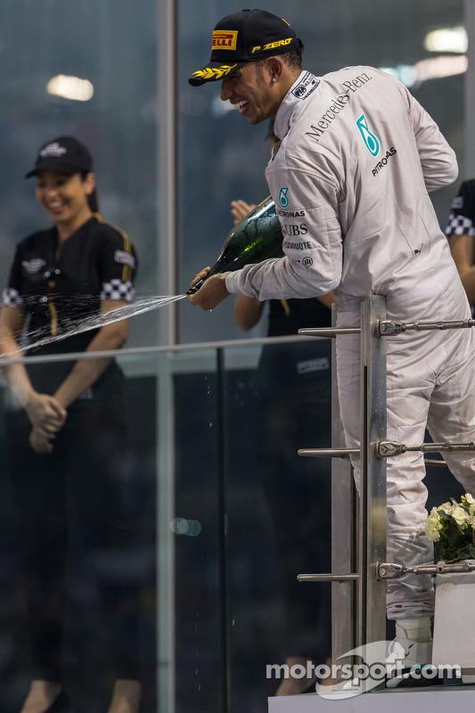 (L to R): Race winner and World Champion Lewis Hamilton, Mercedes AMG F1 celebrates on the podium